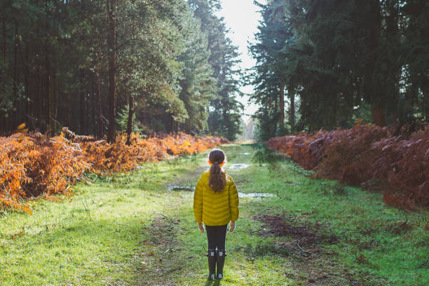 Young girl on path in forest