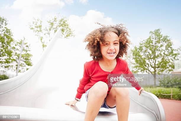young girl on slide having fun
