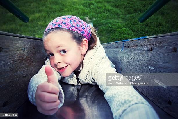 Young girl on slide