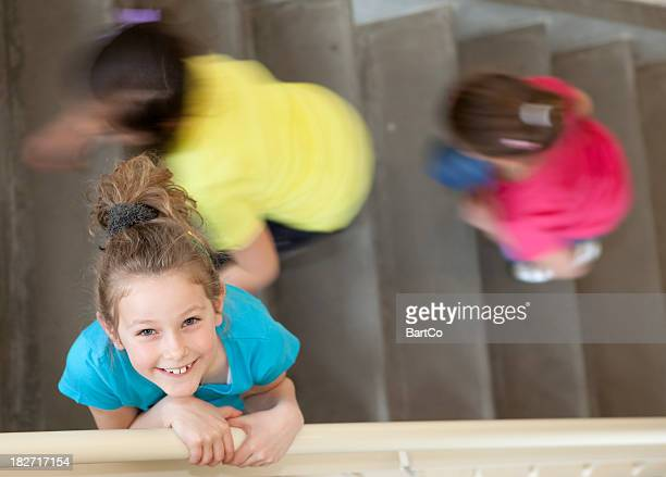 young girl on stairs in her school