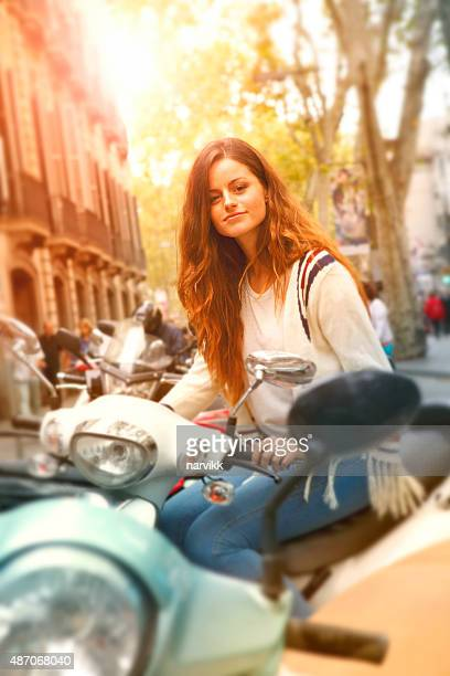 young girl on the scooter in the town - moped stock photos and pictures