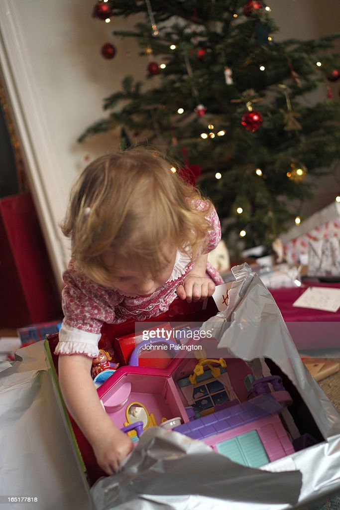 Young Girl Opening Christmas Presents : Foto de stock