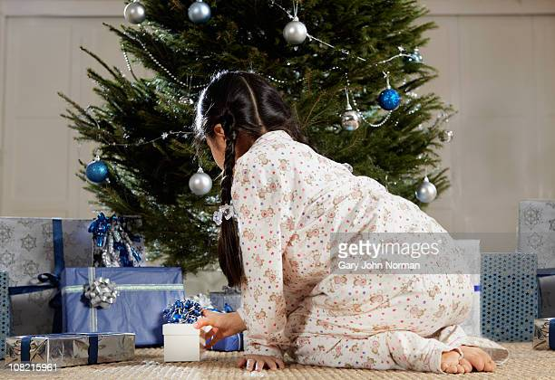 Young girl opening gifts christmas