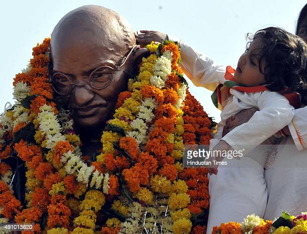 A young girl paying tribute to the statue of Mahatma Gandhi on the occasion of Gandhi Jayanti on October 2 2015 in Indore India Gandhi Jayanti is a...