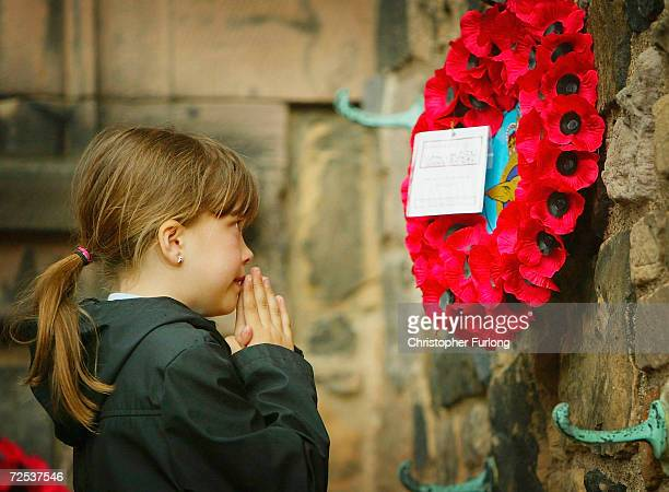Young girl pays her respects to the war dead on May 28, 2004 in Edinburgh, Scotland. Old soldiers of the Normandy Veterans Association gathered at...