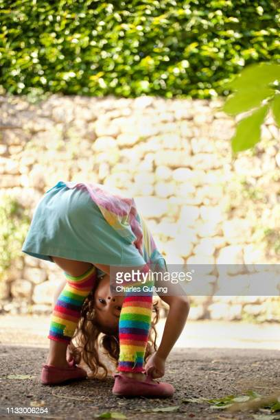 young girl peeking between legs - bending over in skirt stock pictures, royalty-free photos & images