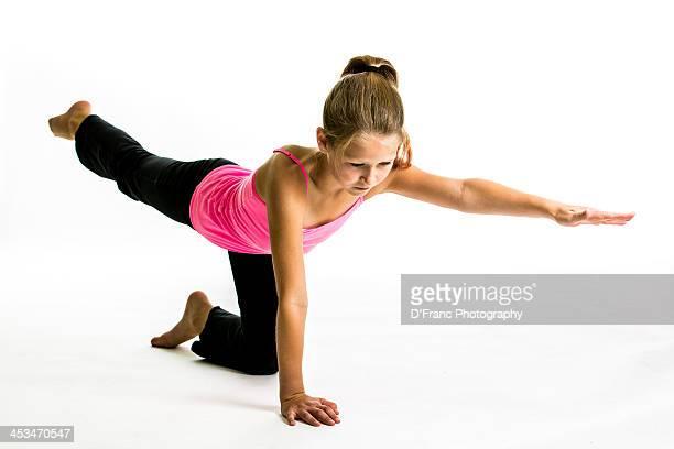 young girl performs yoga