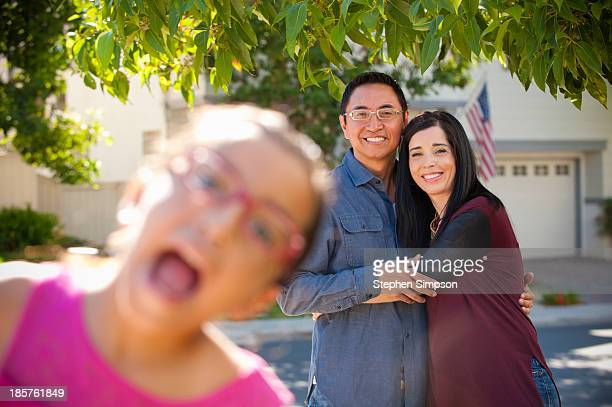 "young girl ""photo bombing"" her parents' photo"