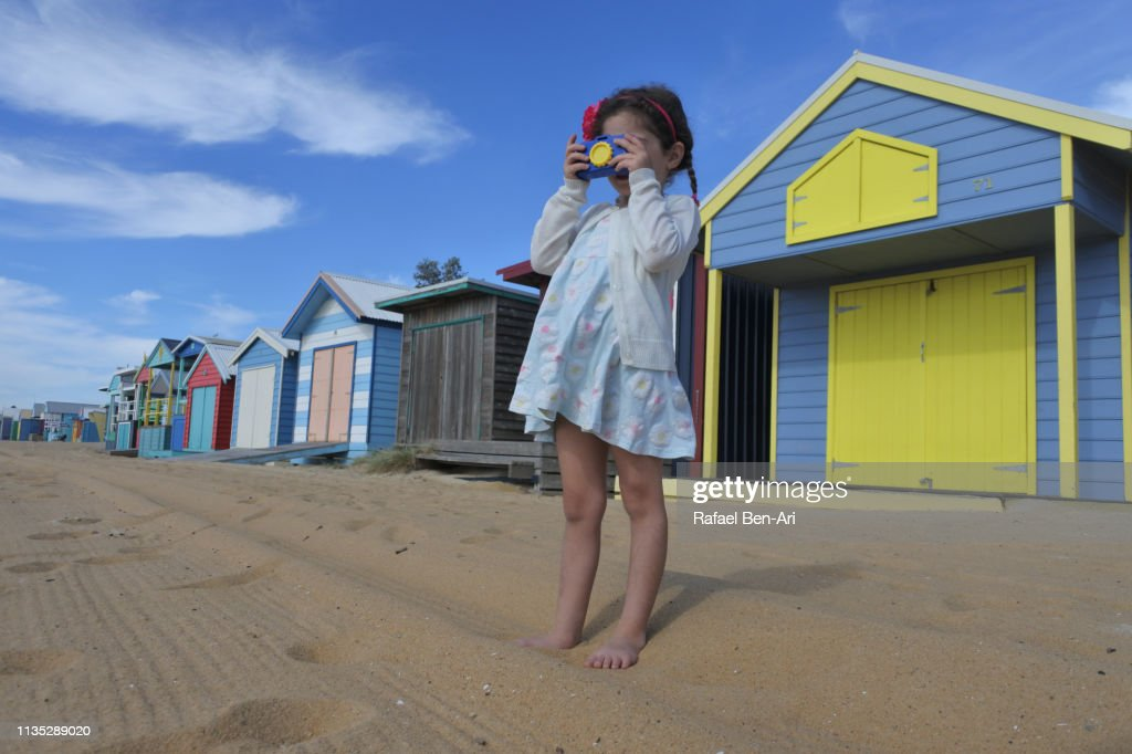 Young girl photographing the Iconic Bathing Boxes of the Mornington Peninsula Victoria Australia : Stock Photo