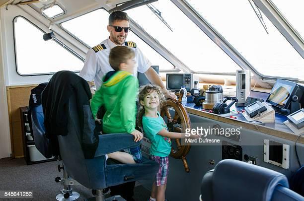 Young girl piloting big yatch