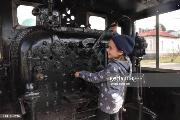 young girl playing a train driver - rafael ben ari bildbanksfoton och bilder