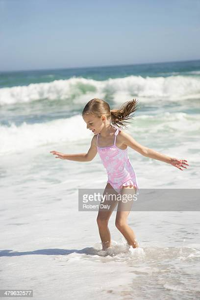 A young girl playing at beach