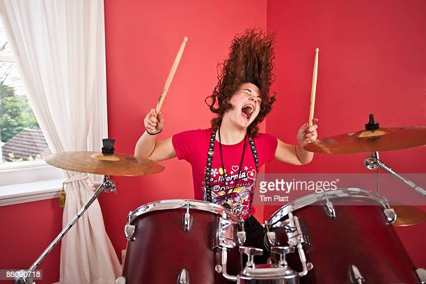young girl playing drums - drum kit stock photos and pictures