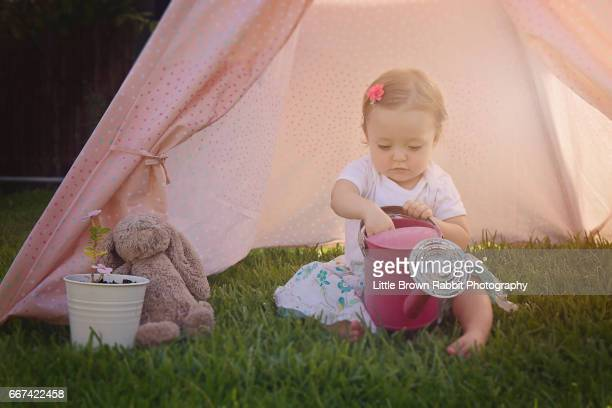 Young Girl Playing in a Pink Teepee Tent