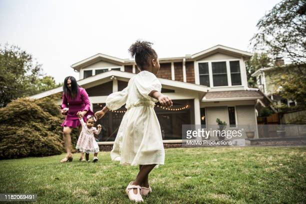 young girl (3 yrs) playing in backyard - american culture stock pictures, royalty-free photos & images