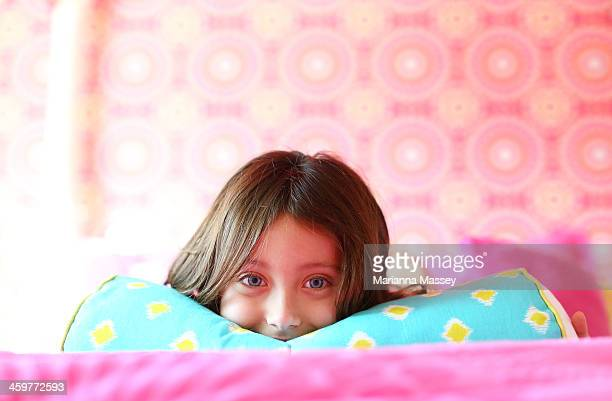 Young Girl playing in bedroom