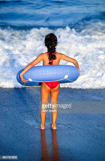 Young girl playing in the ocean surf