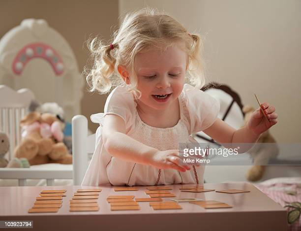 Young girl playing memory game