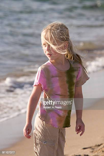 Young girl playing on the beach