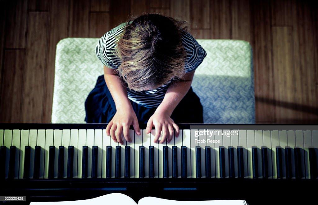 Young girl (10-12) playing piano, Grand Junction, Colorado, USA : Stock Photo
