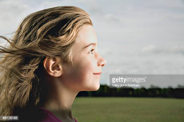 Young girl playing, profile.