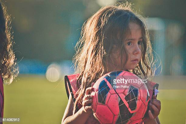 Young girl playing soccer.