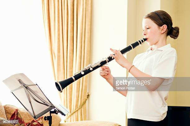A young girl playing the clarinet