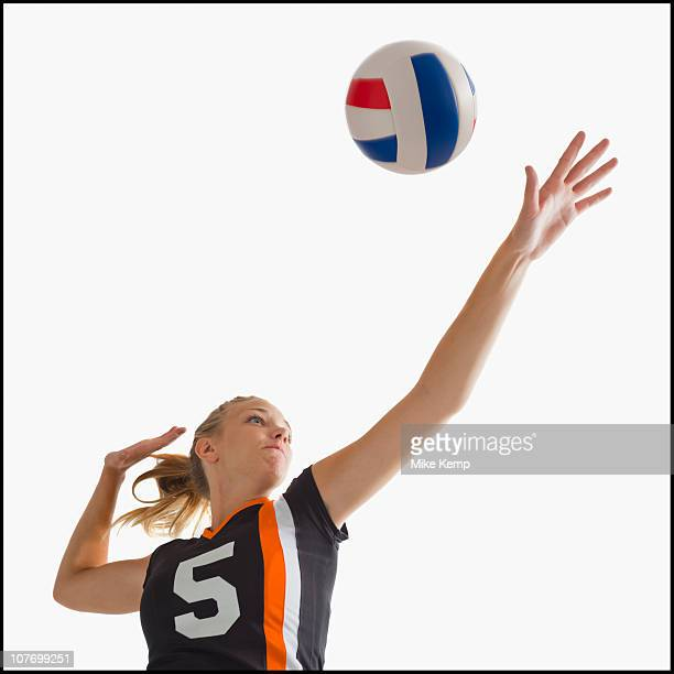 young girl (16-17) playing volleyball - spiking stock photos and pictures