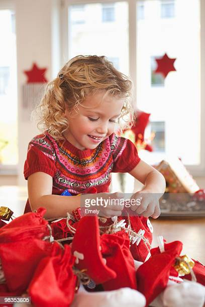 young girl playing with gift sacks
