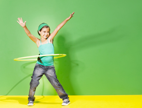 Young girl playing with hula hoop - gettyimageskorea
