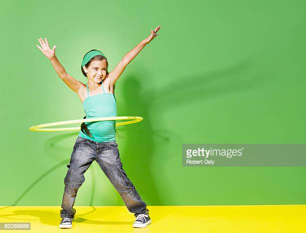 young girl playing with hula hoop - 8 9 years photos stock photos and pictures