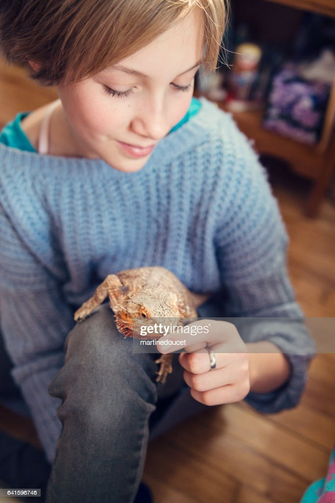 Perfect Young Girl Playing With Lizard Pet In Her Bedroom. : Stock Photo