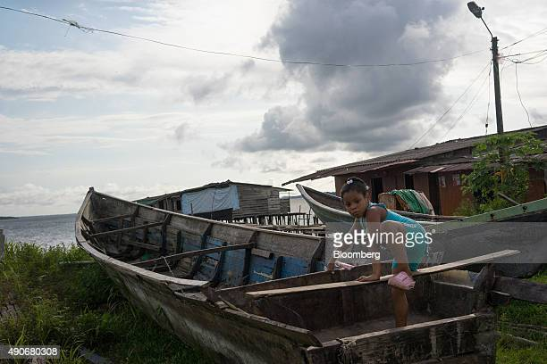 A young girl plays in an empty boat near her house in the Playita neighborhood of Buenaventura Colombia on Tuesday Sept 22 2015 Buenaventura which...