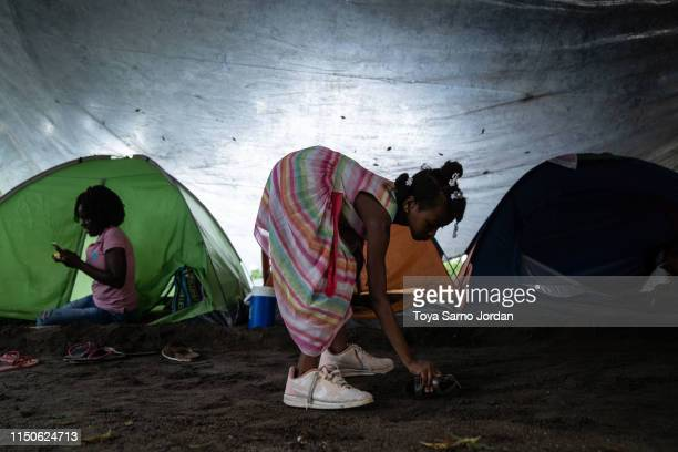 A young girl plays next to a tent where she is temporarily living on June 18 2019 in Tapachula Mexico The Mexican government launched a deployment of...