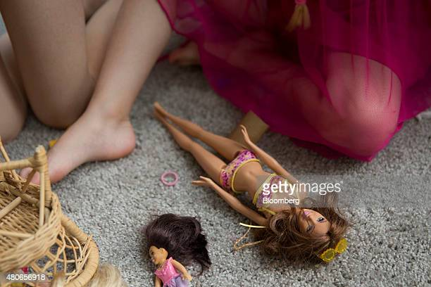 A young girl plays with a Mattel Inc Barbie doll in Tiskilwa Illinois US on Wednesday July 1 2015 Mattel Inc is expected to report quarterly earnings...