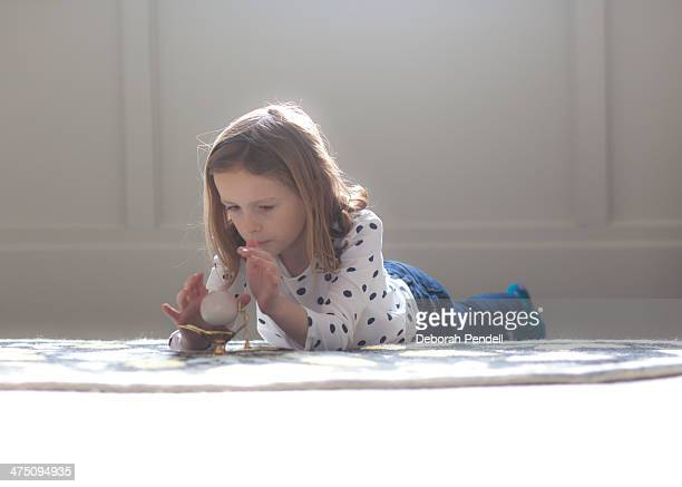 young girl plays with magic lamp and crystal ball - lampara de aladino fotografías e imágenes de stock