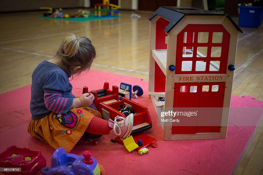 A young girl plays with toys at a playgroup for pre-school aged children in Chilcompton near Radstock on January 6, 2015 in Somerset, England. Along with the health and the economy, education and childcare are to be key issues in the forthcoming election.