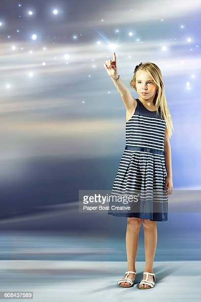 Young girl pointing at stars in the sky