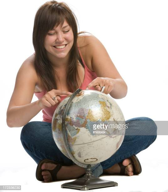 young girl pointing on an area of the globe