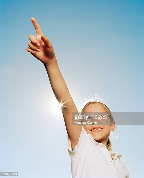 Young girl points to the distance