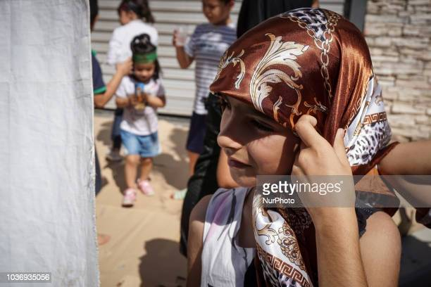 A young girl pose for a photograph prior to the annual commemoration Ashura in Pireaus 20 September 2018 Hundreds of Shiite Muslims gathered in...