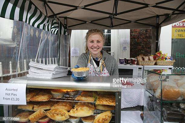 A young girl poses as she sells food outside the ground prior to the Emirates FA Cup Fourth Round match between Carlisle United and Everton at...