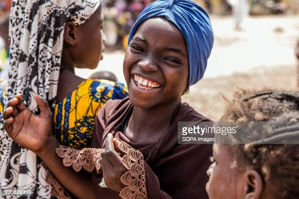 Young girl poses for a photo at TimTooni Football Club, just outside Tamale in Northern Ghana. Along with football coaches from London, time was...
