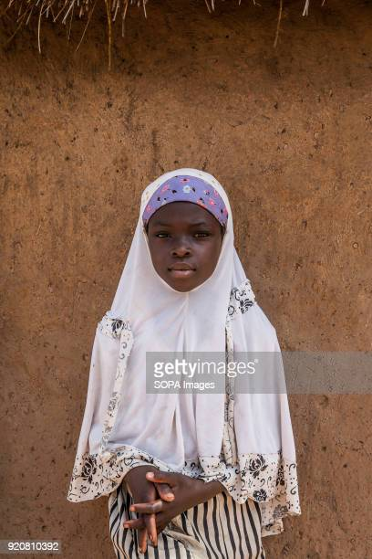A young girl poses for a photo at TimTooni Football Club just outside Tamale in Northern Ghana Along with football coaches from London time was spent...