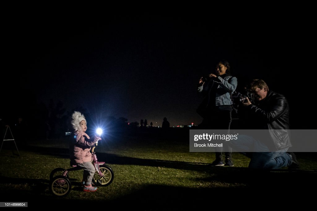 A young girl poses for a photo during the Valley Of Light Public Art Experience at Centennial Park on August 10, 2018 in Sydney, Australia. Hundreds attended the interactive light experience using 100 individual lights of various colours.