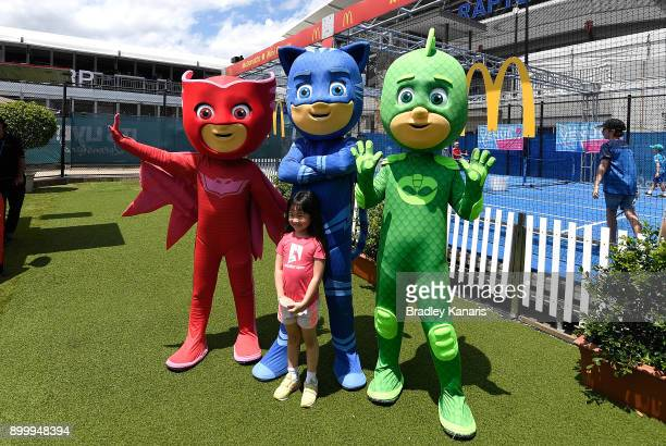 A young girl poses for a photo with kids characters during Kids Day at the 2018 Brisbane International at Pat Rafter Arena on December 31 2017 in...