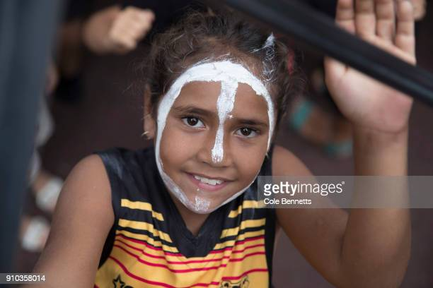 A young girl poses for a portrait at an Invasion Day Rally in Redfern on January 26 2018 in Sydney Australia Australia Day formerly known as...