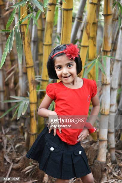 Young girl posing and bamboo trees in the background