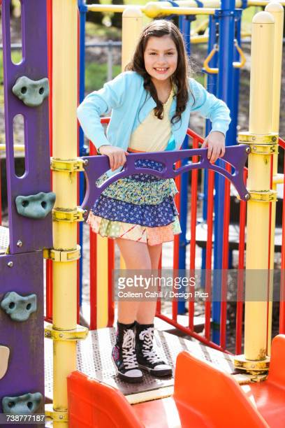 a young girl posing for the camera while playing at the playground - up the skirt pics stock pictures, royalty-free photos & images