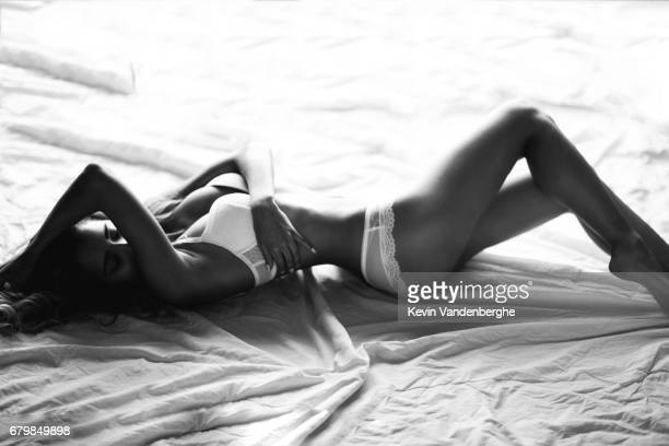 young girl posing in bed with white lingerie